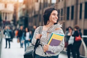 college girl smiling because she has smart money habits